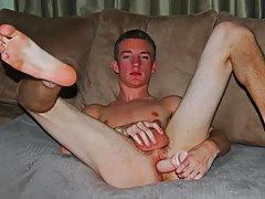 College boy plays with a dildo.